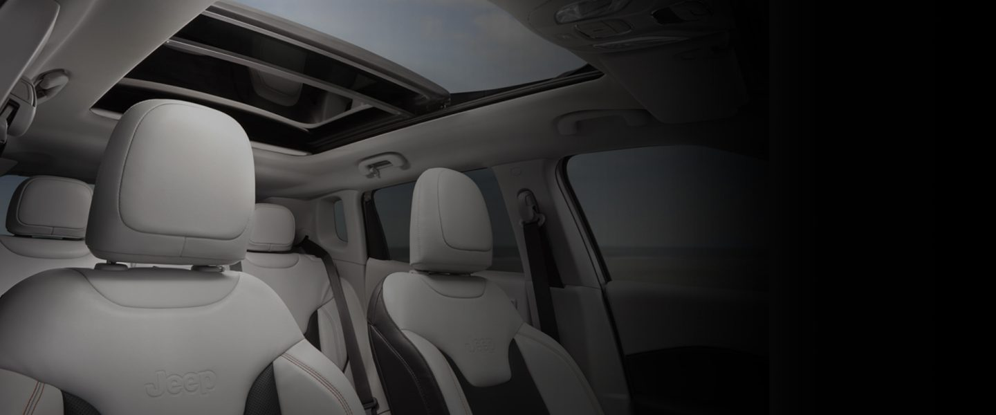 The interior of the 2020 Jeep Compass with the sunroof and front seat headrests visible.