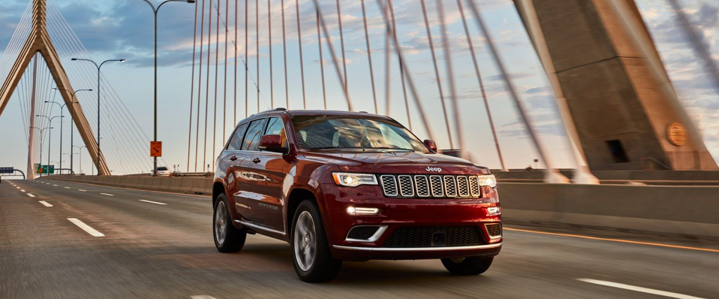 The 2020 Jeep Grand Cherokee being driven over a bridge.